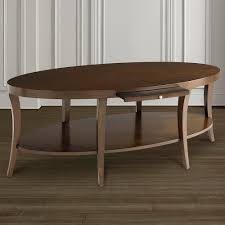 oval coffee table with pullout shelf