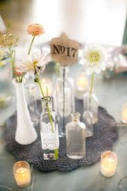 used wedding centerpieces bottles as wedding decor table numbers bottle and wedding