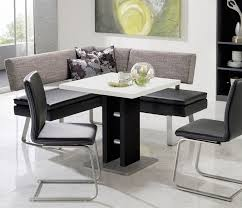 modern black and white dining table and grey fabric bench for