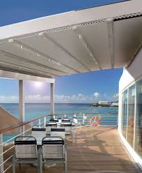 retractable roof pergolas give modern shade to the hospitality