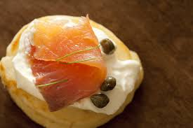 bellini canape free stock photo 12352 blini with thin slice of salmon freeimageslive