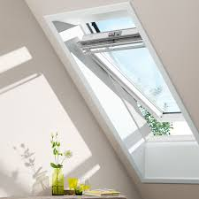 velux 660mm x 980mm white painted finish centre pivot roof window