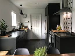 black kitchen cabinets in a small kitchen black kitchen cabinets apartment therapy