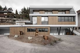 the volume of the three storey house reacts to the topography of