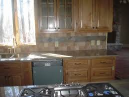 pictures of kitchen backsplashes tile backsplash ideas kitchen layout black granite counter oak