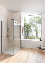 walk in shower with glass doors bathroom featuring borneo roble