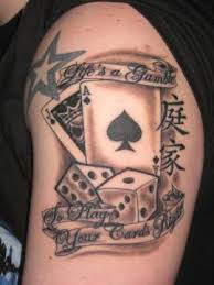 ink cards and dice on left half sleeve