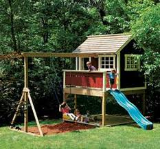outdoor playhouse with swing backyard