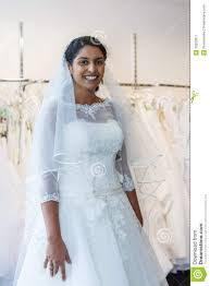 wedding dresses for women indian woman in wedding dress with bridal gowns on display