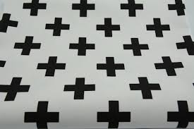 decor black crosses pluses on a white background