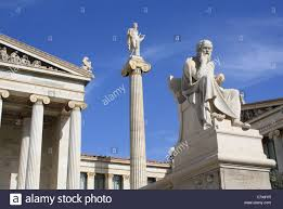 statues of ancient greek philosopher socrates and god apollo