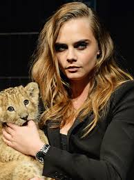 tag heuer ads cara tag heuer and a lion cub