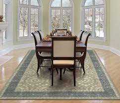 Area Rugs In Dining Rooms Dining Room With Wood Floors Beautiful Patterned Rug And