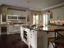 modular shaped kitchen island with glass doors and wine rack for