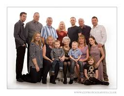 pose for large family in studio posing large groups