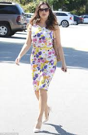 kelly brook shows off her slimmer curves in floral form fitting