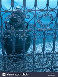 close up of moroccan style wrought iron railings in front of