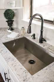 ideas gorgeous bronze faucet and granite countertop plus awesome