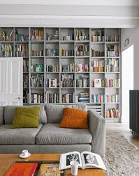grey living room with floor to ceiling bookcases home libraries