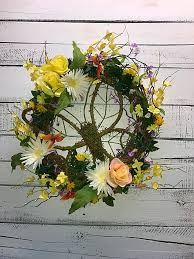 spring wreath featuring large moss covered butterfly spring door