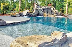 Backyard Pool With Slide - zero beach entries blue haven custom swimming pool and spa builders