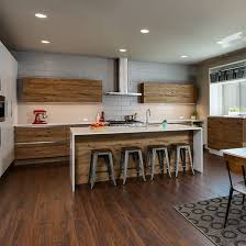 wood tone kitchen cabinets the trends in cabinets mix it up prosource wholesale