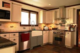 furniture white starmark cabinetry with tile backsplash and