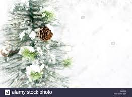 tree with pine cones snow and lights in stock