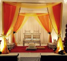 indian wedding decorators in atlanta gold fabric mandap with marigold flowers by aayojan