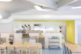 designboom green school atelier 208 wraps synthetic green roof around elementary school