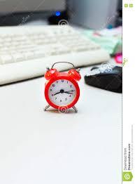 desk alarm clock red small retro alarm clock on white desk stock photo image