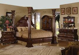 carved wrought iron four poster canopy bed and on brown hardwood