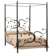 bedroom black stained wooden single canopy bed with carved