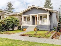 craftman style house blue grey smal craftsman style house with white porch stock photo