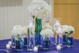 white hydrangea centerpieces with blue water