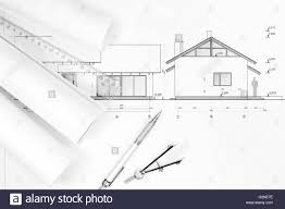 architectural project and house plan blueprints rolled up stock
