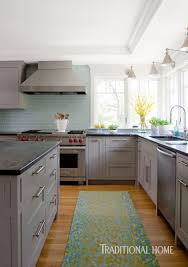 coastal kitchen with a bright bump out traditional home