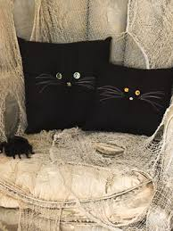halloween crafts black cat pillows at womansday com
