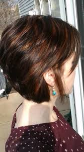 brunette hairstyle with lots of hilights for over 50 chocolate brown base red highlights short hair clothes and cuts