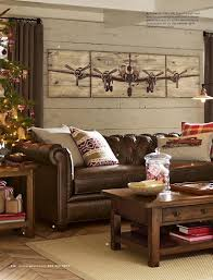 pottery barn chesterfield sofa love the washed knotty pine wall behind the pottery barn