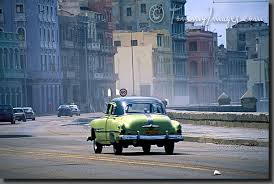 stock photos pictures a classic car drives on the malecon as
