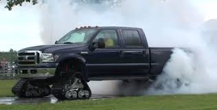 Ford Raptor Snow Truck - ford f 350 on tracks does burnout and smoke show autoevolution