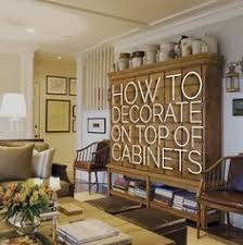 Top Of Kitchen Cabinet Decorating Ideas by How To Decorate Above Kitchen Cabinets Decorating Kitchens And