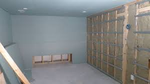 q1 front wall post safe n sound insulation and double drywall on