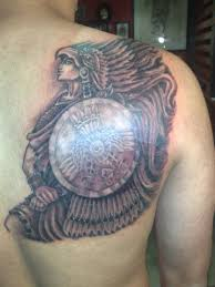 aztec warrior tattoo on man right back shoulder