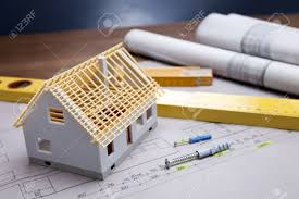 construction plans and blueprints on wooden table stock photo