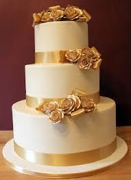 white wedding cake with gold ribbon the world s catalog of ideas