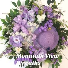 springtime with a straw hat and lavender peonies