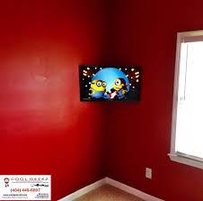 kid room setup done tv mounted in corner on a full motion bracket