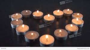 made out of lit small candles blowing them o stock